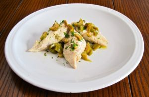 "Chicken ""poached"" in extra virgin olive oil, olives, capers and lemon."