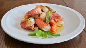 Prawns wrapped in prosciutto roasted with olive oil, sage and garlic