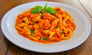 Strozzapreti pasta and prawns in a roasted red bell pepper sauce