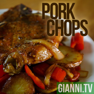 Pork chops with peppers, onions and potatoes
