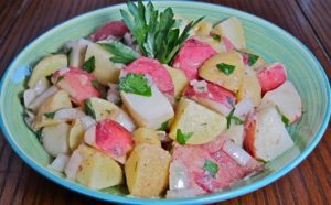 Creamy red & gold potatoes bathed with buttery olive oil and mellow red wine vinegar
