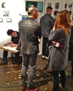 An artist at work in the midst of Live Worms Gallery crowds