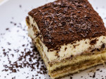 "Tiramisu, the Italian ""pick-me-up"" with mascarpone cream and ladyfingers soaked in espresso & Marsala with chocolate all over"